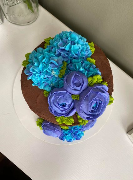 A Chocolate Cake with Buttercream Flowers