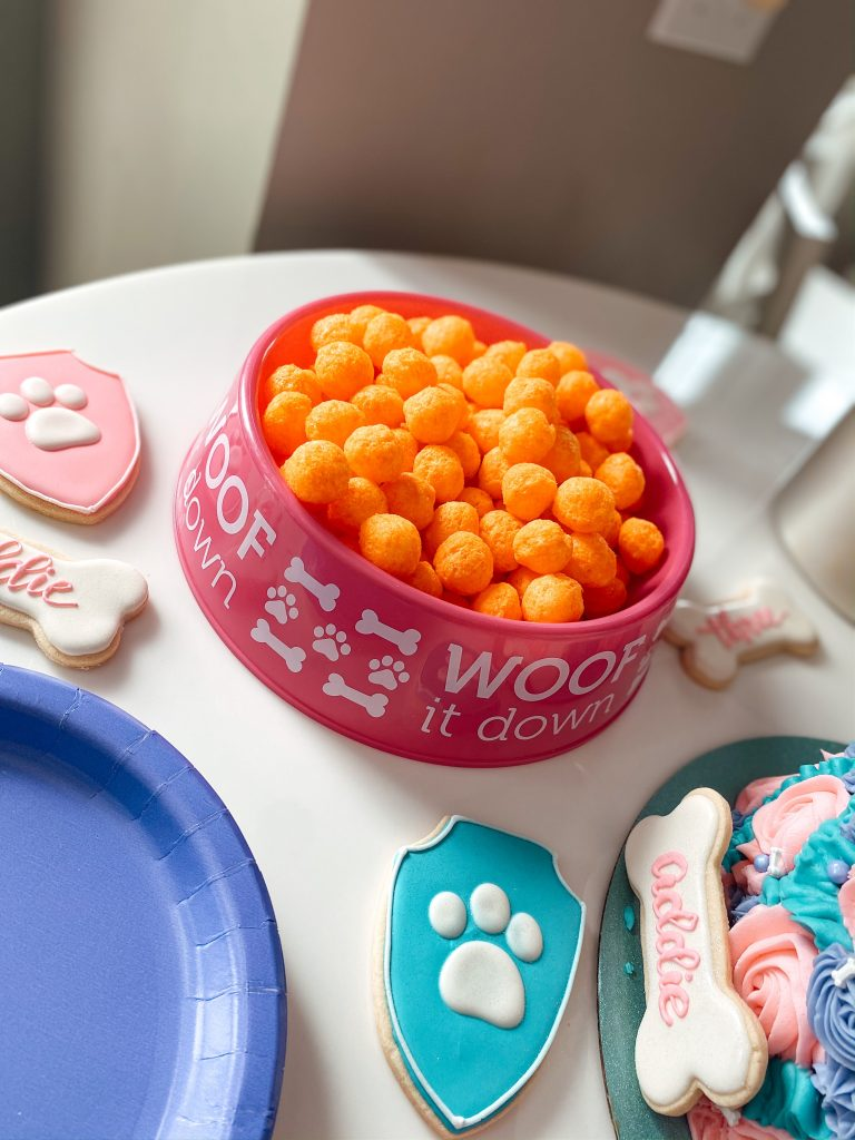 Dog Bowl filled with cheese balls as a snack for a Paw Patrol party