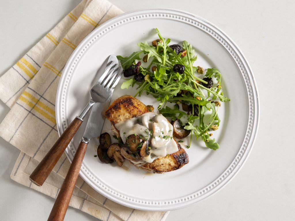 Mushroom and Swiss Chicken withFruit and Nut Arugula Salad