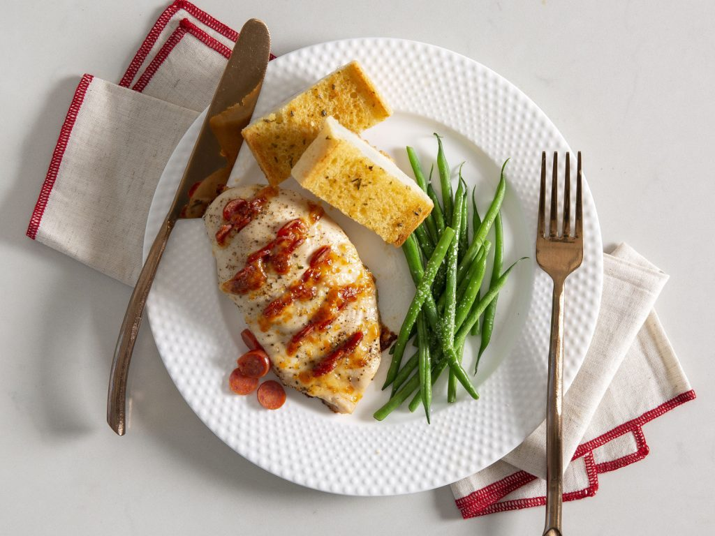 Hasselback Pepperoni Chicken with Green Beans and Garlic Bread