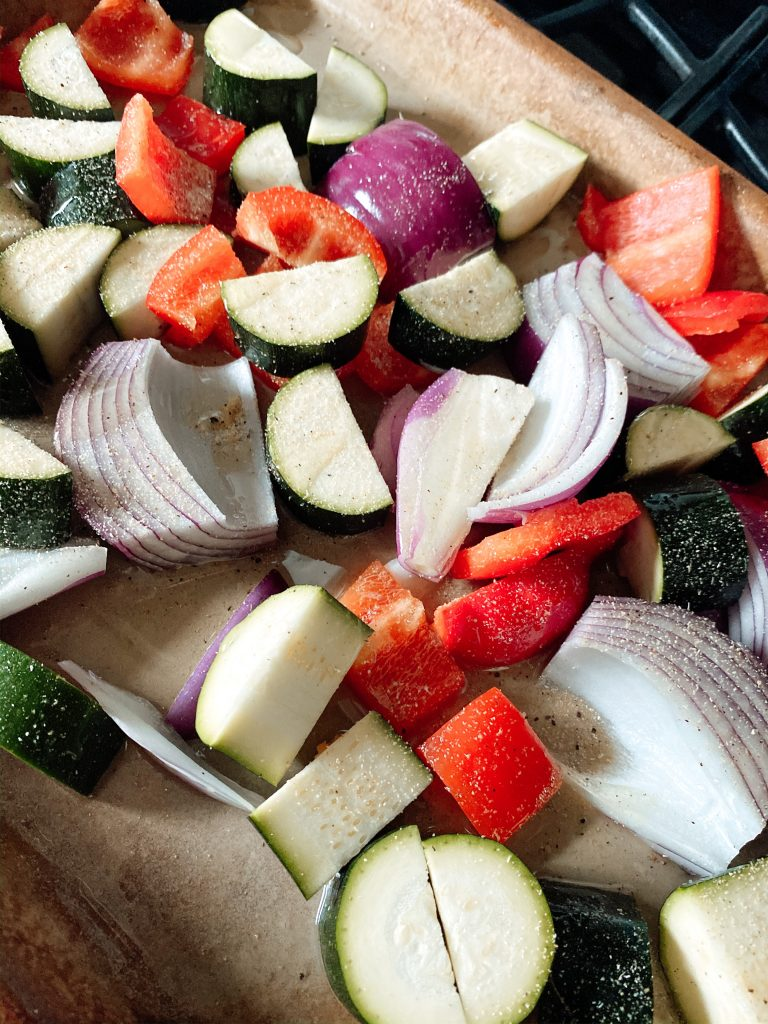 Cut up vegetables to roast on a bar pan
