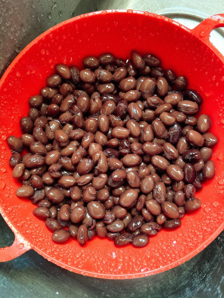 Black beans in a strainer