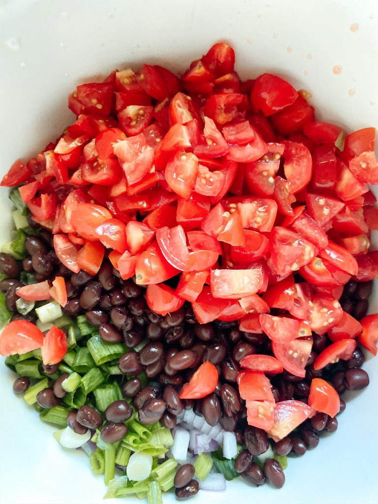 Tomato, Black Bean, Onions in mixing bowl