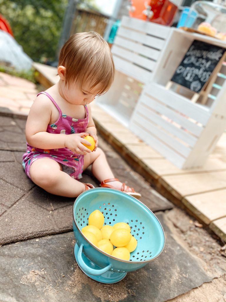 Toddler with fake lemons