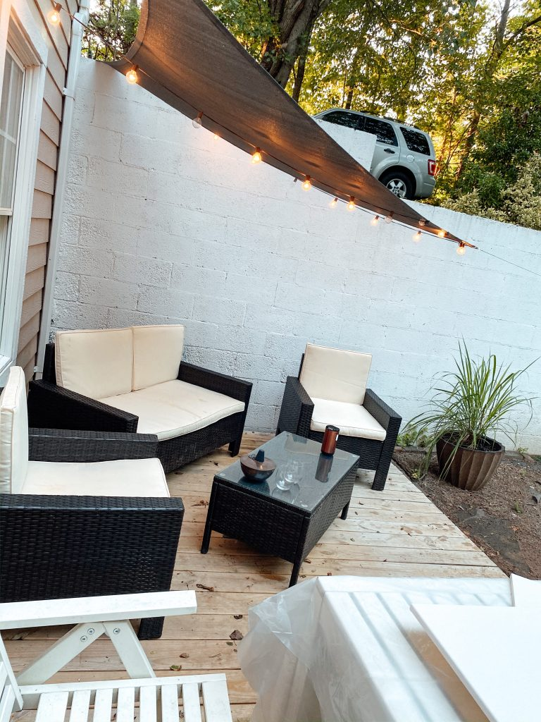 Floating Deck with Patio furniture and cafe lights