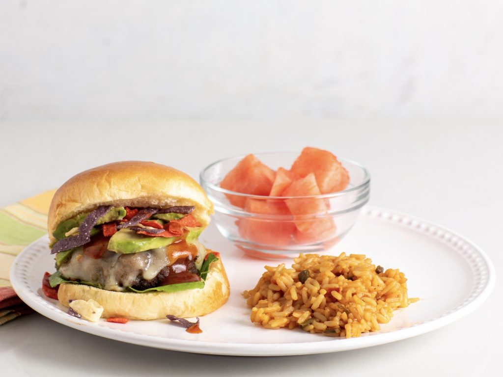 Mexican Crunch Cheeseburgers withCheesy Yellow Rice and Summer Fruit