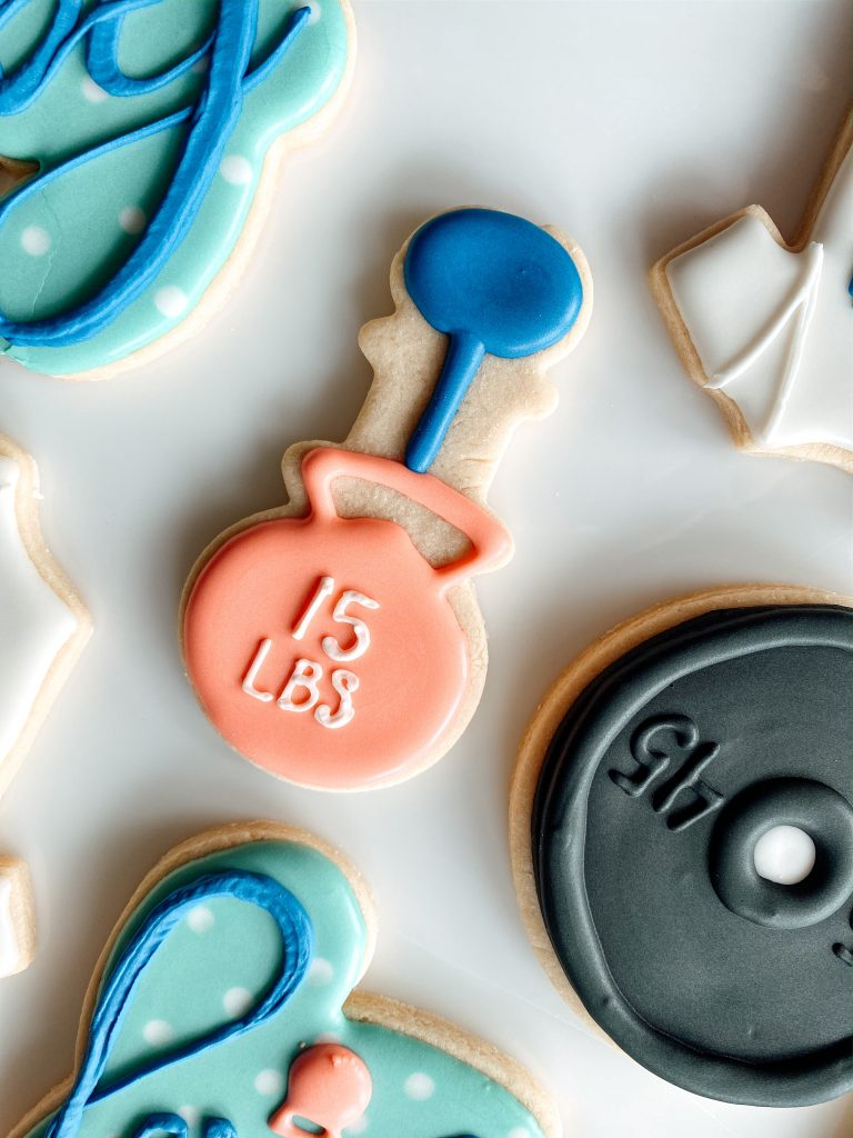 Kettlebell baby rattle cookie