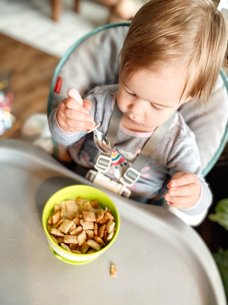 Baby Using Grabease Stainless Steel Baby Utensils to eat cereal